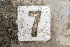 The digits with concrete on the sidewalk 7 Stock Photography