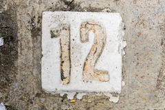 The digits with concrete on the sidewalk 12. Digits with concrete on the sidewalk 12 Stock Photography