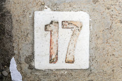 The digits with concrete on the sidewalk 17. Digits with concrete on the sidewalk 17 Royalty Free Stock Photo