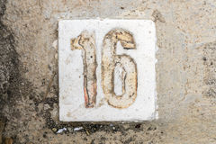 The digits with concrete on the sidewalk 16 royalty free stock image