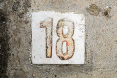 The digits with concrete on the sidewalk 18. Digits with concrete on the sidewalk 18 Royalty Free Stock Images