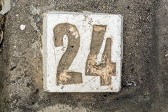 The digits with concrete on the sidewalk 24. Digits with concrete on the sidewalk 24 Stock Photo