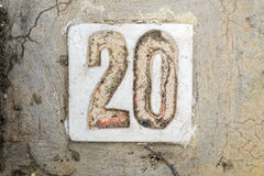 The digits with concrete on the sidewalk 20. Digits with concrete on the sidewalk 20 Royalty Free Stock Image