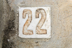 The digits 22 with concrete on the sidewalk. Digits 22 with concrete on the sidewalk Stock Image