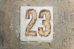 The digits with concrete on the sidewalk 23. Digits with concrete on the sidewalk 23 Royalty Free Stock Photography