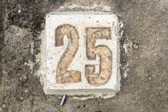The digits with concrete on the sidewalk 25 Royalty Free Stock Image