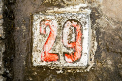 The digits with concrete on the sidewalk 29 Stock Image