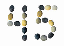 Digits 4, 5 made of pebbles. Stock Photo