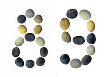 Digits 8, 9 made of pebbles. Digits 8, 9 made of pebbles on a white background Stock Image