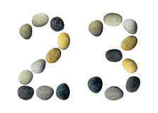 Digits 2, 3 made of pebbles. Digits 2, 3 made of pebbles on a white background Royalty Free Stock Photo