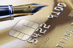 Digits and pen on credit card close-up. Composition of digits and pen on credit card close-up Royalty Free Stock Image