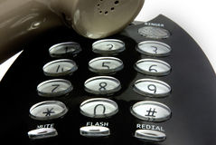 Digits and speaker of a black telephone Stock Photos