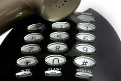 Digits und Lautsprecher eines schwarzen Telefons stockfotos