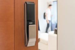 Digtal door lock on wooden door. Interior design concept Royalty Free Stock Photo