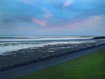 Digue au coucher du soleil, Terschelling Photo libre de droits