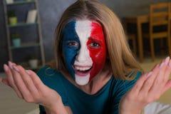Diisappointed kobieta z malującą flaga Francja Obrazy Stock