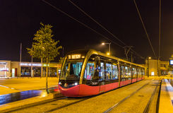DIJON, FRANCE - NOVEMBER 01: Alstom Citadis 302 tram on the cent. Ral station on November 1, 2013 in Dijon, France. Dijon tramway system was inaugurated on 01.09 Stock Photos
