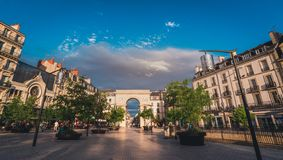 Dijon triumphal arch square in evening sunset stock image