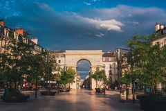 Dijon triumphal arch square in evening sunset stock photos