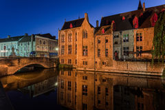 Dijver Canal in Bruges Belgium. The Dijver canal with its historical buildings and reflected on the waters at night Stock Photo