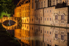 Dijver Canal in Bruges Belgium. The Dijver canal with its historical buildings reflected on the waters at night Stock Images