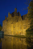 Dijver Canal in Bruges at night. Historic houses along Dijver Canal in Bruges at night. (Belgium Stock Photo