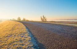 along a frozen lake at sunrise Stock Photo