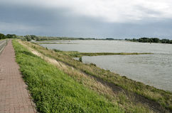 Dike along The Waal. Royalty Free Stock Images