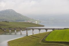 Dike with bridge Stock Images