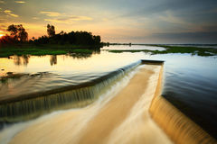 Dike ,Dam. Water flowing from the dam,  Water Gates for Irrigation Royalty Free Stock Photos