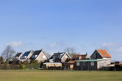 Dike houses in Dutch polder landscape Royalty Free Stock Image