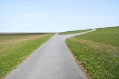 Dike. Way to and parallel to a dike in North Frisia, Germany stock images