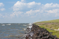 Dike with windmills  in the Netherlands Royalty Free Stock Images