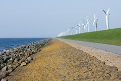 Dike with windmills in the Netherlands Stock Photo