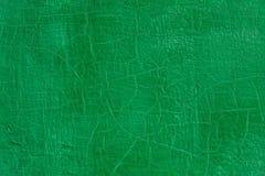 Dikke groene verse olieverf op de vlakke naadloze textuur van de staaloppervlakte met oude barsten onder het royalty-vrije stock foto