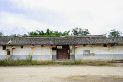Dilapidated ancient Chinese dwelling house against cloudy sky Royalty Free Stock Image
