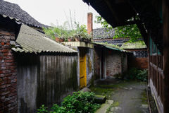 Dilapidated ancient Chinese houses in lichen-covered alley Stock Photos
