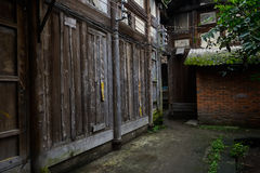 Dilapidated ancient Chinese wood structural dwelling building Royalty Free Stock Photo