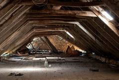 Dilapidated attic. A retro dilapidated abandoned attic interior Royalty Free Stock Photo