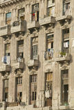 Dilapidated balconies with laundry hanging out to dry in Havana, Cuba Royalty Free Stock Image