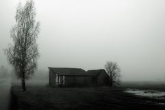 Dilapidated barn in fog Royalty Free Stock Photos