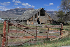 Dilapidated Barn with Gate Stock Image