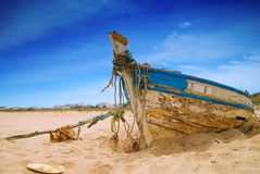 Dilapidated Boat. Dilapidated fishing boat in the sand Stock Photography