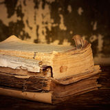 Dilapidated books on a wooden surface, sepia Royalty Free Stock Image
