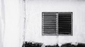 Dilapidated building. The dilapidation of the old white building stock image