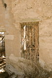 Dilapidated, building window. Royalty Free Stock Image