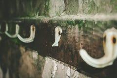 Dilapidated coat hook Stock Photos