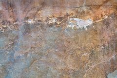 Dilapidated concrete wall with cracks and scratches, textural ba Stock Photo