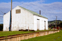 Dilapidated Corrugated Iron Storage Shed Alongside Railway track Stock Photo