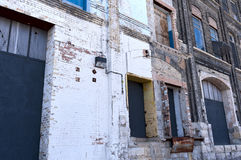 Dilapidated Dock Bays of Vacant Warehouse Stock Images